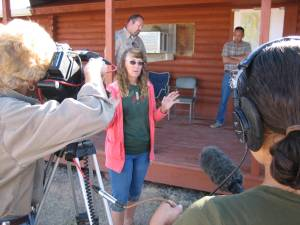 Sue Cattoor speaking at Pryor Mt. 2009 Roundup while Ginger Kathrens films - Photo by R.T. Fitch