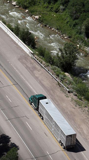 truck hauling horses travels the highway near Helper, Friday, Aug. 5 ...