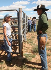 Photo by Sam Minkler Navajo activist Leland Grass (right) confronts horse buyer Jeanne Collom