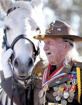 Cavalryman Sgt. Allan MacDonald and his horse, Comanche II. (DAVID ROYAL/The Herald)