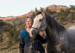 Carol Walker and her mustang companion, Mica.