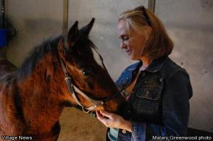 "Malary Greenwood photo - ""Foster Mom"" Linda Harris talks sweetly to her rescued foal, Morning Star."
