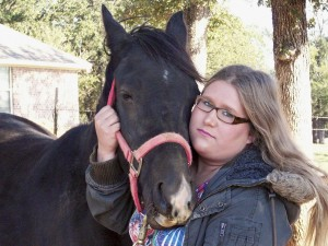 Meghan with Cass Oles Beau, a grandson of the horse that starred in the movie The Black Stallion. Horses have helped the Rio Vista, Texas, teen deal with her autism.  Photo courtesy of Meghan Dixon