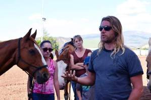 Rupert Isaacson, front, explains the Horse Boy method during a demonstration at the Carbondale rodeo grounds as helpers Zoe Hanlon and Mel Wiley watch.