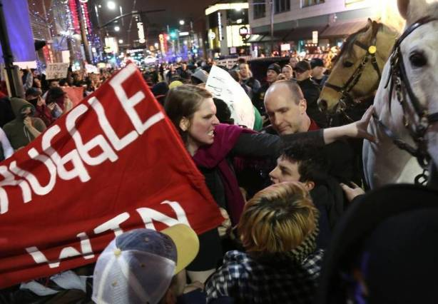 A angry protester pushed a police horse outside the Donald Trump rally March 12 in Kansas City. Christopher Smith Special to The Kansas City Star